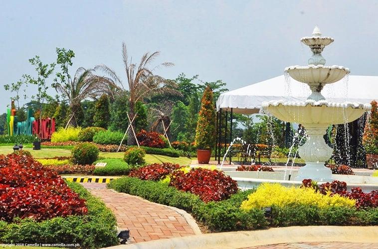 Camella Balanga garden with fountain