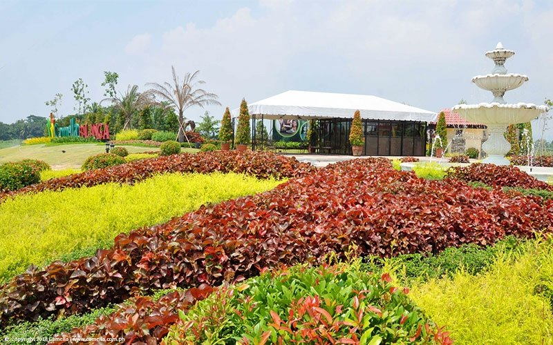 Camella Balanga sales office with garden and fountain