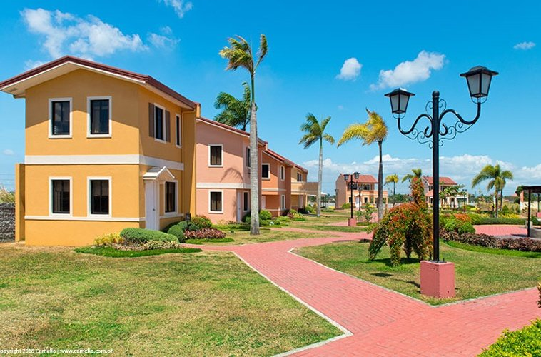 Camella Dasma at The Islands marker house and lot units with pathway and garden