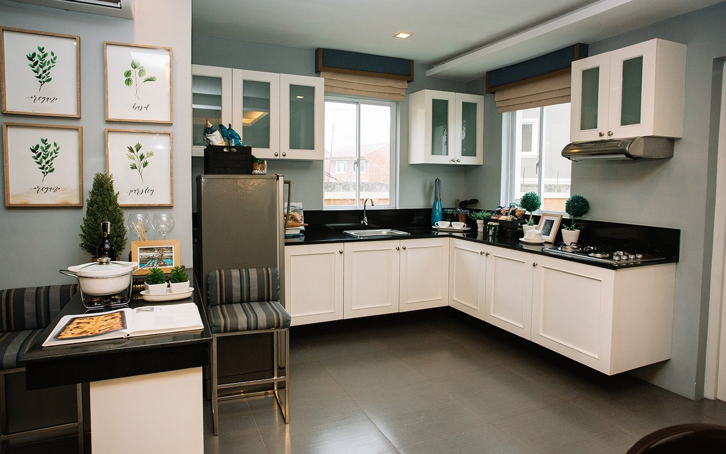 Ella home kitchen with bar area