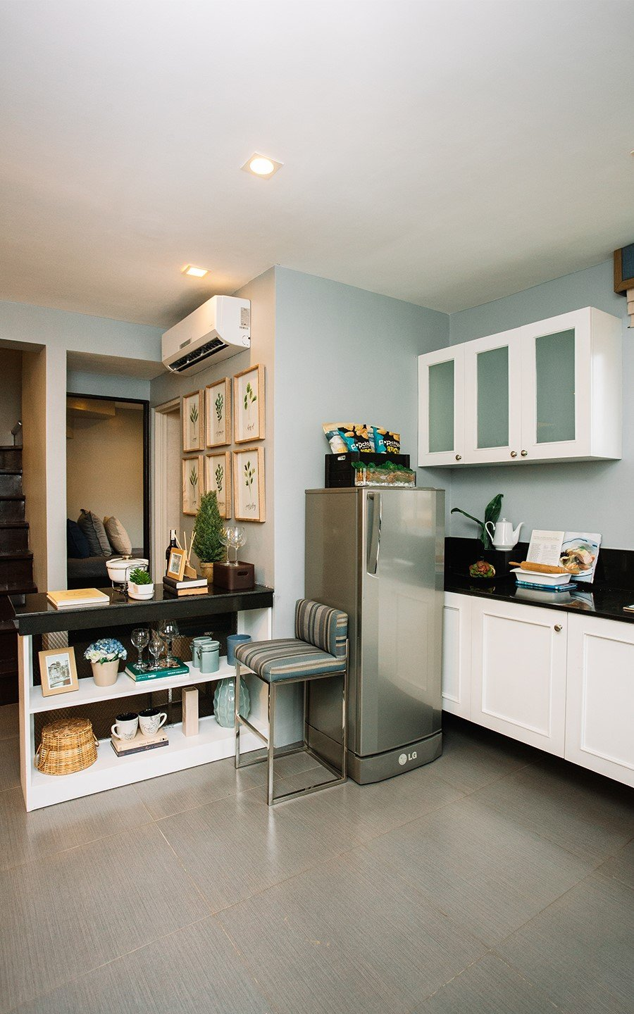 Ella home kitchen area with refrigerator